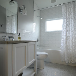 Example of a small transitional master white tile marble floor bathroom design in Seattle with white cabinets, a one-piece toilet, gray walls, an undermount sink and recessed-panel cabinets