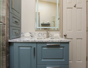 Small Masterbath with Green Cabinetry, Custom Tiled Shower and Storage