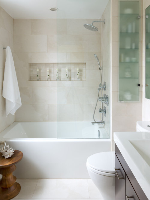 example of a trendy beige tile alcove bathtub design in toronto with flat panel cabinets