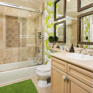 Bathroom - mediterranean beige tile bathroom idea in Los Angeles with a drop-in sink, raised-panel cabinets, medium tone wood cabinets and multicolored walls