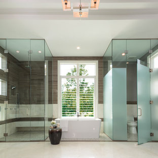 Example of a huge trendy master brown tile, white tile and porcelain tile marble floor and white floor bathroom design in Miami with shaker cabinets, dark wood cabinets, a one-piece toilet, gray walls, a vessel sink, quartzite countertops and a hinged shower door