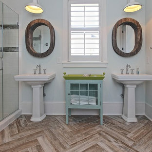 Coastal white tile and subway tile bathroom photo in Charleston with a pedestal sink