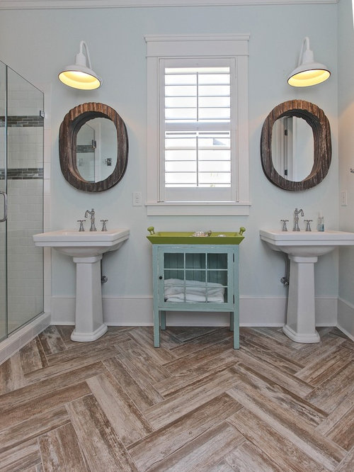 Coastal bathroom photo in Charleston with a pedestal sink, white tile and  subway tile - Distressed Wood Floors Houzz