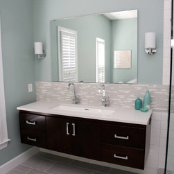 "Sodo Collection - Gorgeous and serene bath remodel with a vanity from our Sodo Collection. This special order is a 65"" vanity in Chocolate Cherry with Slab doors."