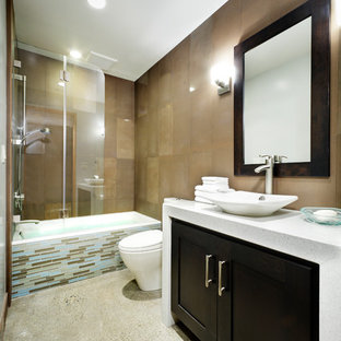 Example of a mid-sized trendy blue tile, brown tile and matchstick tile concrete floor bathroom design in Sacramento with shaker cabinets, dark wood cabinets, a one-piece toilet, brown walls, a vessel sink and quartzite countertops