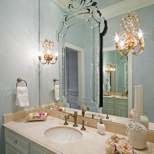 Immagine di una grande stanza da bagno con doccia chic con lavabo sottopiano, ante con riquadro incassato, ante bianche, pareti blu, top in marmo, top beige, un lavabo e mobile bagno incassato