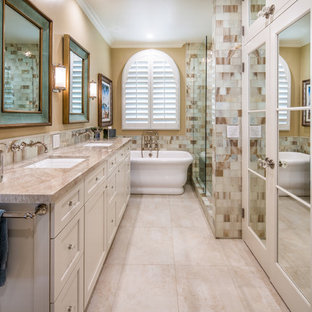 Beach style master beige tile and white tile beige floor bathroom photo in San Diego with recessed-panel cabinets, beige cabinets, beige walls, an undermount sink and beige countertops