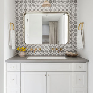 Mid-sized cottage kids' ceramic tile and multicolored tile porcelain floor, gray floor and double-sink bathroom photo in San Diego with shaker cabinets, white cabinets, white walls, a trough sink, quartz countertops, gray countertops and a built-in vanity