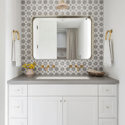 Mid-sized cottage kids' ceramic tile and multicolored tile porcelain tile, gray floor and double-sink bathroom photo in San Diego with shaker cabinets, white cabinets, white walls, a trough sink, quartz countertops, gray countertops and a built-in vanity