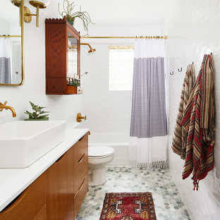 Bathroom - transitional white tile and subway tile mosaic tile floor and gray floor bathroom idea in Austin with flat-panel cabinets, medium tone wood cabinets, white walls, a vessel sink and white countertops