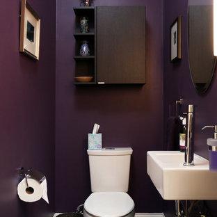 Idee per una piccola stanza da bagno moderna con ante lisce, ante in legno bruno, WC a due pezzi, pareti nere, pavimento in gres porcellanato e lavabo sospeso