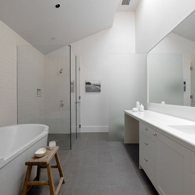 Example of a minimalist gray floor bathroom design in San Francisco with white countertops