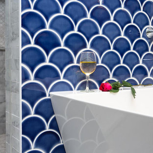 Bathroom - mid-sized transitional master blue tile and mosaic tile porcelain tile and gray floor bathroom idea in Milwaukee with flat-panel cabinets, white cabinets, a two-piece toilet, gray walls, an undermount sink, marble countertops, a hinged shower door and gray countertops