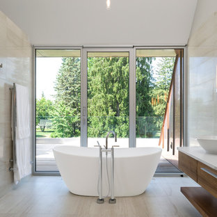 Contemporary bathroom in Ottawa with a vessel sink and a freestanding tub.
