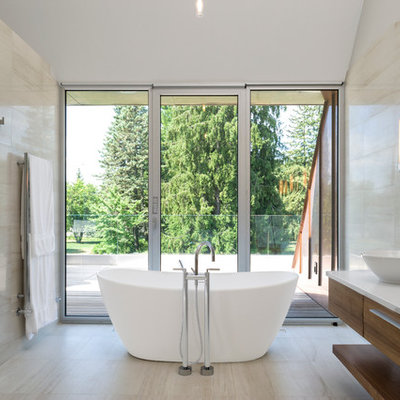 Example of a trendy freestanding bathtub design in Ottawa with a vessel sink
