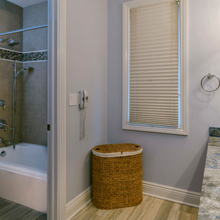 Large classic family bathroom in Chicago with a submerged sink, beaded cabinets, green cabinets, marble worktops, a built-in bath, an alcove shower, a two-piece toilet, grey tiles, stone tiles, beige walls and marble flooring.