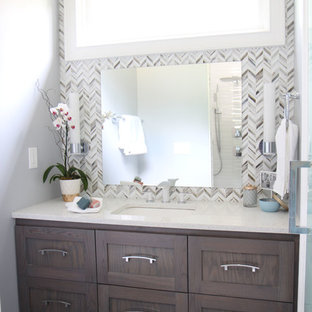 Medium sized contemporary family bathroom in Atlanta with beaded cabinets, dark wood cabinets, a double shower, a two-piece toilet, white tiles, ceramic tiles, grey walls, porcelain flooring, a vessel sink, engineered stone worktops, grey floors, a hinged door and white worktops.