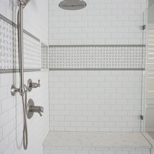 Example of a large classic master white tile and subway tile porcelain tile bathroom design in St Louis with an undermount sink, beaded inset cabinets, dark wood cabinets, quartzite countertops and green walls