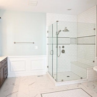 Bathroom - large traditional master white tile and subway tile porcelain floor bathroom idea in St Louis with an undermount sink, beaded inset cabinets, dark wood cabinets, quartzite countertops and green walls