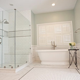 Example of a large classic master white tile and subway tile porcelain floor bathroom design in St Louis with an undermount sink, beaded inset cabinets, dark wood cabinets, quartzite countertops and green walls