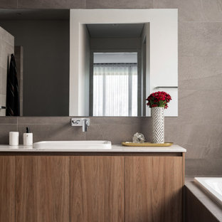Mid-sized contemporary master bathroom in Perth with flat-panel cabinets, medium wood cabinets, a drop-in tub, an alcove shower, gray tile, ceramic floors, a drop-in sink, engineered quartz benchtops, grey floor, an open shower and white benchtops.
