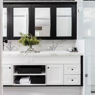 Inspiration for a transitional 3/4 bathroom in Sydney with shaker cabinets, white cabinets, white tile, subway tile, white walls, a drop-in sink, marble benchtops and black floor.