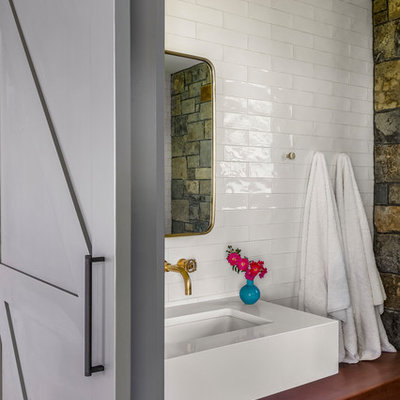 Bathroom - small rustic 3/4 white tile and subway tile porcelain tile bathroom idea in New York with open cabinets, medium tone wood cabinets, a one-piece toilet, a trough sink and wood countertops