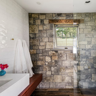 Inspiration for a small rustic 3/4 white tile and subway tile porcelain floor and brown floor bathroom remodel in New York with wood countertops, white walls, an undermount sink and brown countertops