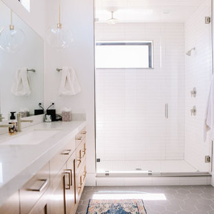 Wet room - large modern master porcelain tile and gray floor wet room idea in Salt Lake City with shaker cabinets, light wood cabinets, white walls, an undermount sink, quartz countertops, a hinged shower door and white countertops