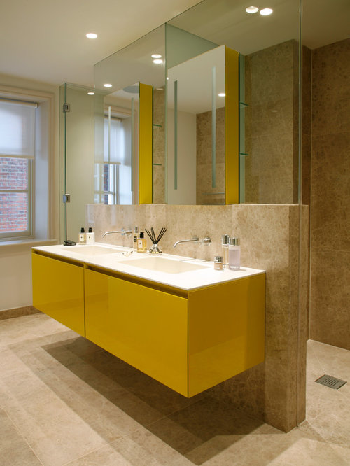 Inspiration For A Bathroom Remodel In London With Yellow Cabinets