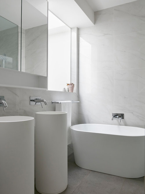 Photo Of A Modern Master Bathroom In Melbourne With Freestanding Tub Grey Walls