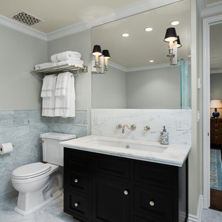 Bathroom - traditional gray tile bathroom idea in Los Angeles with an undermount sink, shaker cabinets, black cabinets, a two-piece toilet and gray walls