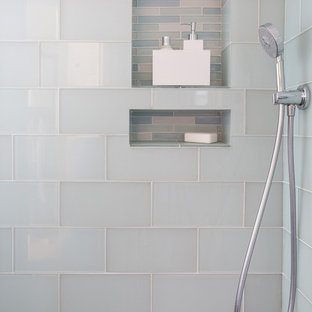 Inspiration for a mid-sized contemporary 3/4 glass tile porcelain floor corner shower remodel in Los Angeles with flat-panel cabinets, white cabinets, solid surface countertops, a one-piece toilet and gray walls