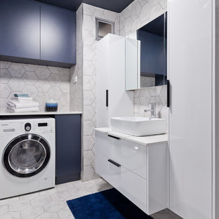 Inspiration for a contemporary 3/4 bathroom in Perth with flat-panel cabinets, blue cabinets, white tile, a vessel sink, white floor and white benchtops.