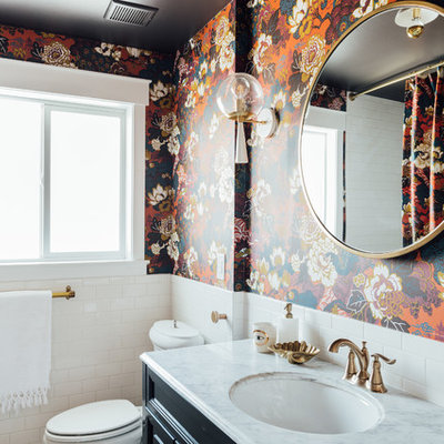 Mid-sized eclectic 3/4 white tile and ceramic tile porcelain tile and white floor bathroom photo in Salt Lake City with shaker cabinets, blue cabinets, a one-piece toilet, multicolored walls, an integrated sink, marble countertops and white countertops