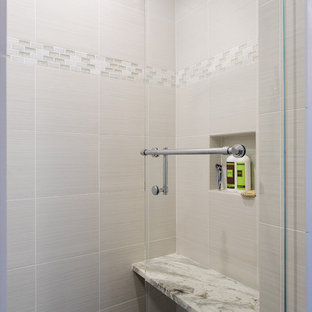 Inspiration for a mid-sized contemporary master beige tile and stone slab slate floor alcove shower remodel in Boston with an undermount sink, light wood cabinets, beige walls, granite countertops and raised-panel cabinets