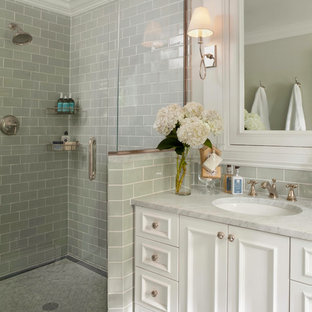 Inspiration for a small timeless master green tile and ceramic tile marble floor corner shower remodel in Denver with recessed-panel cabinets, white cabinets, a one-piece toilet, green walls, an undermount sink and marble countertops
