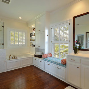 Inspiration for a timeless white tile bathroom remodel in Austin with an undermount sink, recessed-panel cabinets and white cabinets