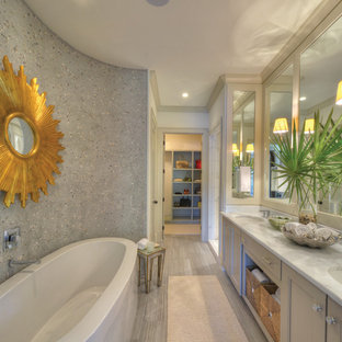 Design ideas for a coastal bathroom in Jacksonville with recessed-panel cabinets and grey cabinets.