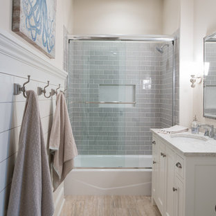 Beach style 3/4 gray tile and glass tile beige floor bathroom photo in Minneapolis with recessed-panel cabinets, white cabinets, beige walls and an undermount sink