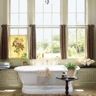 Inspiration for a rural bathroom in Atlanta with a freestanding bath, beige walls and slate flooring.