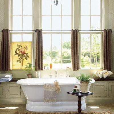 Cottage slate floor freestanding bathtub photo in Atlanta with beige walls