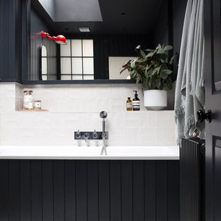 Inspiration for a medium sized contemporary family bathroom in London with grey tiles and ceramic tiles.