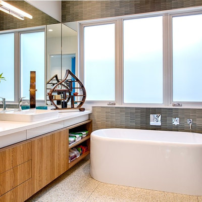 Inspiration for a contemporary freestanding bathtub remodel in Houston with a vessel sink