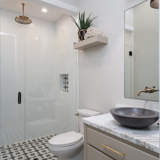 Transitional 3/4 white tile multicolored floor and single-sink walk-in shower photo in Dallas with gray cabinets, a two-piece toilet, white walls, a vessel sink, a hinged shower door, multicolored countertops, a niche and a freestanding vanity