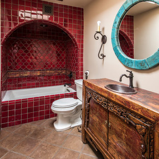 Southwest 3/4 red tile beige floor bathroom photo in Phoenix with flat-panel cabinets, dark wood cabinets, a two-piece toilet, beige walls, a drop-in sink and wood countertops