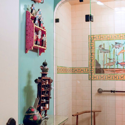 Alcove shower - mid-sized southwestern master multicolored tile, white tile and mosaic tile terra-cotta tile and brown floor alcove shower idea in San Francisco with furniture-like cabinets, blue walls and a hinged shower door