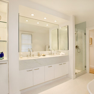 Bathroom - contemporary blue tile and subway tile bathroom idea in Boston with an undermount sink, flat-panel cabinets and white cabinets