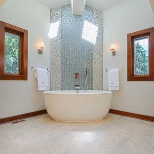 Foto de cuarto de baño principal, asiático, grande, con armarios con paneles lisos, puertas de armario de madera oscura, bañera exenta, ducha empotrada, baldosas y/o azulejos azules, baldosas y/o azulejos de vidrio, paredes blancas, suelo de mármol, lavabo bajoencimera y encimera de acrílico