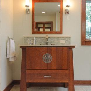 Esempio di una grande stanza da bagno padronale etnica con ante lisce, ante in legno scuro, vasca freestanding, doccia alcova, piastrelle blu, piastrelle di vetro, pareti bianche, pavimento in marmo, lavabo sottopiano e top in superficie solida